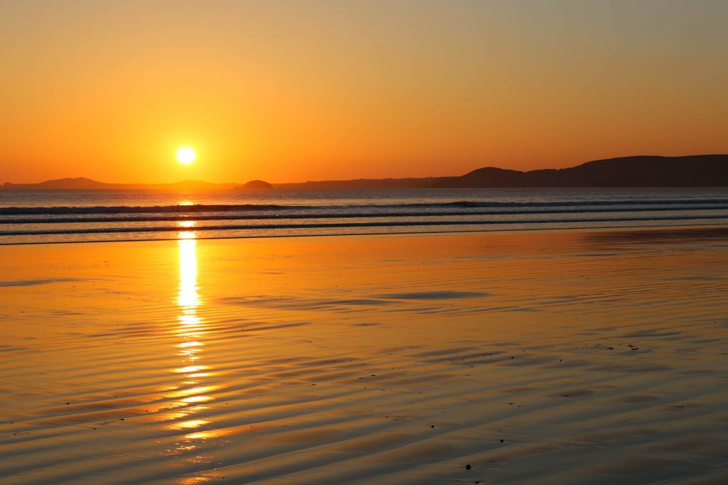 Beautiful sunset at Newgale Beach Pembrokeshire - a beach life